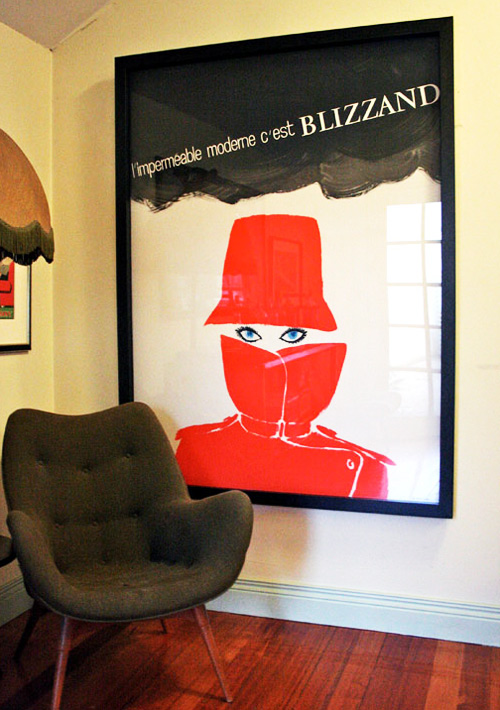 vintage-poster-red-hat-coat-living-room